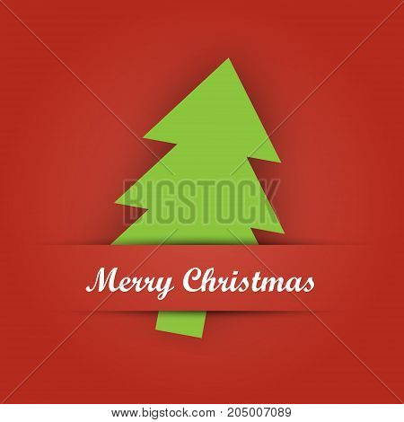 Christmas card paper pocket with green tree papercut and Merry Christmas label on red background.