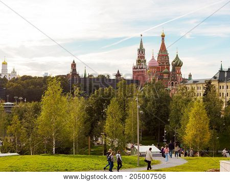 Moscow,  Zaryadye park. View of the Moscow Kremlin and St. Basil's Cathedral. People walk in the park. Autumn landscape. 20 september 2017