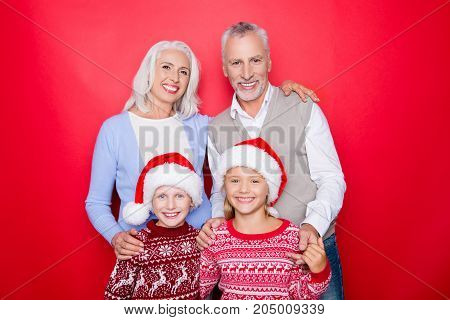 Four Caucasian Relatives Bonding Isolated On The Red Background, Married Elder Couple Of Grandad And