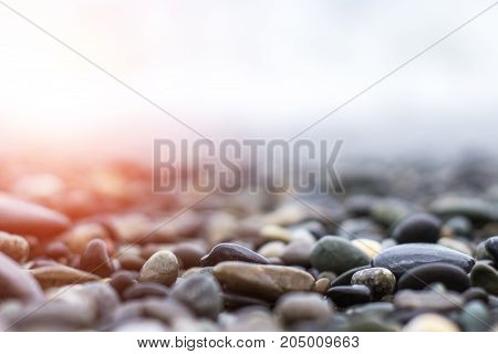 Wet Sea Pebbles With A Wave After A Storm With A Shallow Depth Of Field