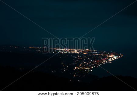 Panoramic Night View Of The City From A Great Height From The Mountain