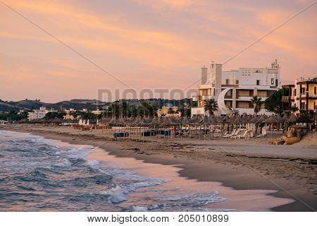 ALBANIA GOLEM- September 21 2015: Evening beach at sunset in the resort of Golem on the Adriatic coast.