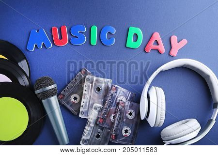 Headphones, Vinyl Records, Cassette Tapes And Microphone With Inscription Music Day