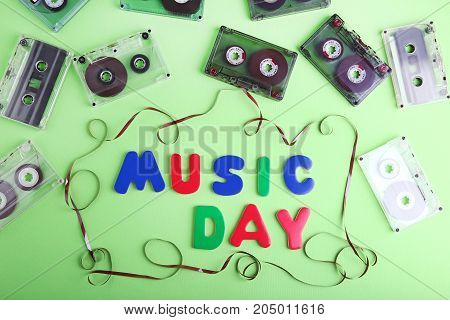 Cassette Tapes With Inscription Music Day On Green Background