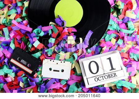 Vinyl Records With Cassette Tapes And Wooden Cubes On Colourful Confetti