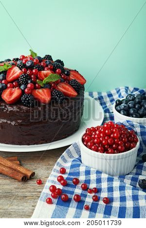 Chocolate Cake With Berries In Plate On Wooden Table