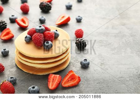 Tasty Pancakes With Berries On Grey Wooden Table
