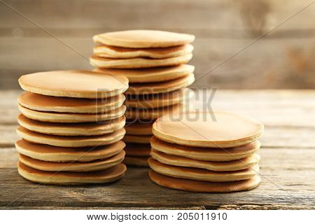 Tasty pancakes on the grey wooden table