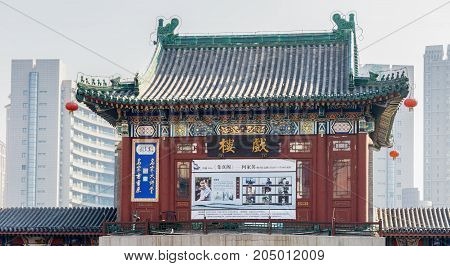 Tianjin, China - Nov 1, 2016: Tianjin Ancient Cultural Street, preserved in the classical Qing Dynasty architectural style. Morning scene at gate structure to what is a very popular tourist area.