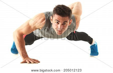 Fitness Man Wringing From The Floor Isoladed On White