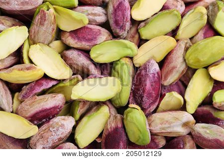 Heap of ripe and tasty pistachios background