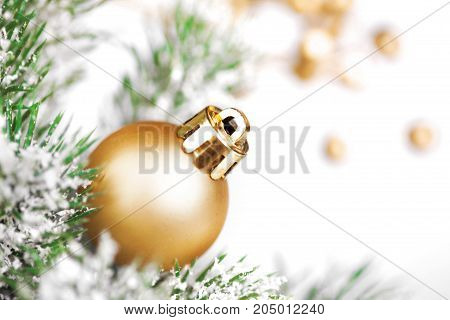 Golden Christmas decoration on tree. Xmas concept