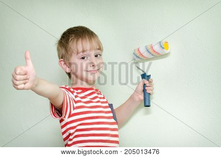 Boy With A Paint Roller And A Thumb Up