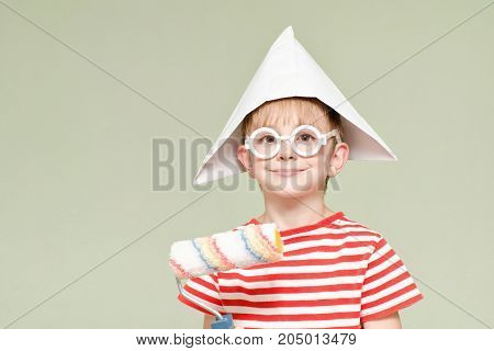 Вoy In A Paper Hat With A Paint Roller. Portrait