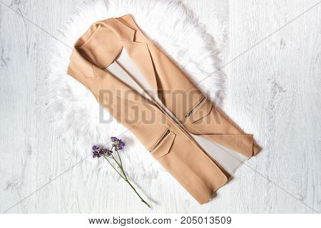 Trench Sand Color, Wild Flowers. Fashionable Concept On White Fur