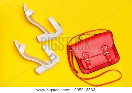 Fashionable Concept. Red Handbag And White Shoes. Yellow Background, Top View