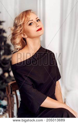 Poof beautiful woman with makeup in fashion clothesrtrait