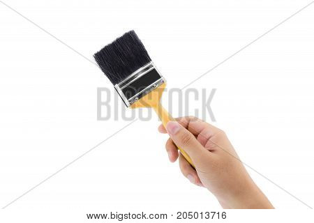 man hand with paint brush with wood handle isolated on a white background.