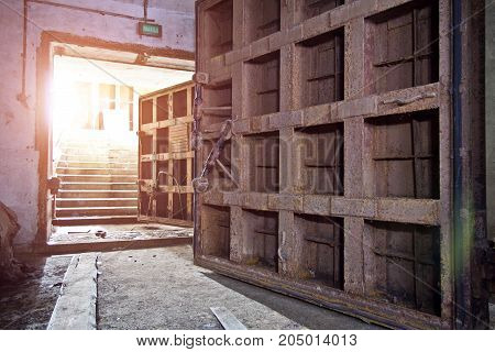 Big rusty heavy steel hermetic doors in the abandoned Soviet bomb shelter