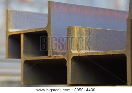 Metal profile beam in packs at the warehouse of metal products Russia
