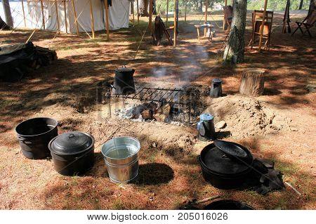 Civil War reenactment camp on a sunny summer day.