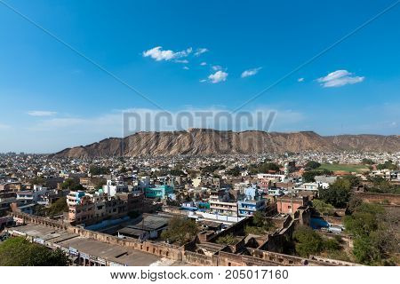 JAIPUR RAJASTHAN INDIA - MARCH 11 2016: Horizontal picture from Jama Masjid minaret of houses and local stores in the city of Jaipur known as pink city in India.