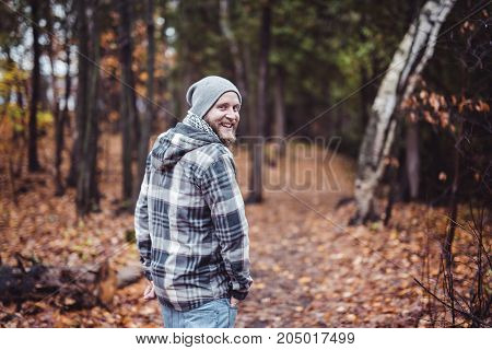 A Young man in the autumn park