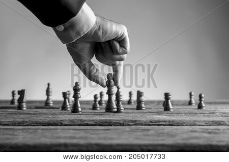 Man In Business Suit Playing Chess Moving The King Piece
