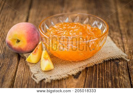 Fresh Made Peach Jam On A Rustic Background