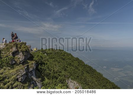 Tourist on Velky Choc hill in north Slovakia in summer sunny day