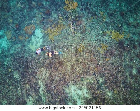 Couple doing snorkel activity above aerial view