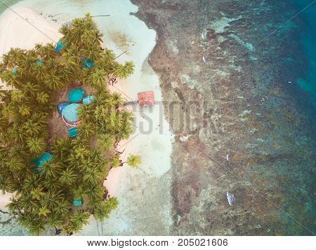 Small tropical island above view on sunny light day