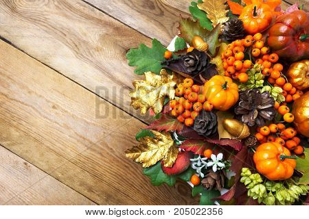 Fall Arrangement With Frame Of Pumpkins, Berries And Cones