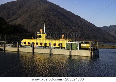 Yellow boat, yellow submarine, Motosu Lake, Japan