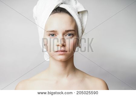 Beautiful woman with towel on the head looking to camera