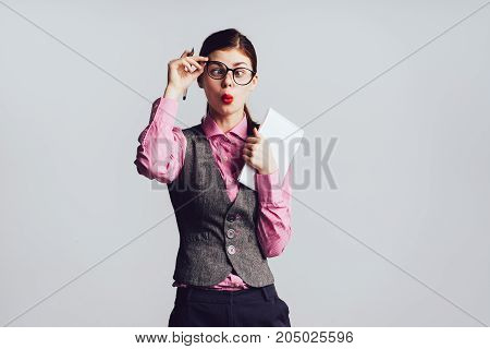 Surprised girl office worker, student with funny face makes faces, tired