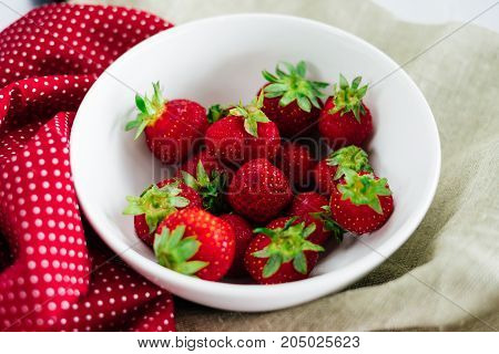 Fresh raw healthy diet strawberries fruit in plate,isolated on white,view above,flatlay close-up,copyspace for text,frame.Village rustic  canvas,countryside food