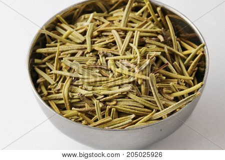 Rosemary in a bowl on white background