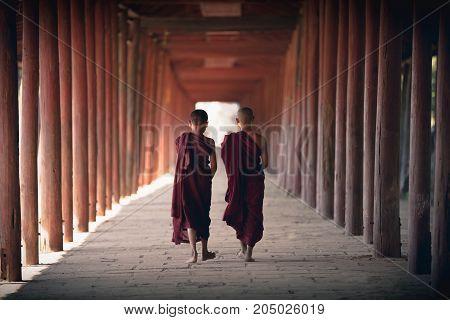 Little monks walking at old temple Salay Bagan Myanmar