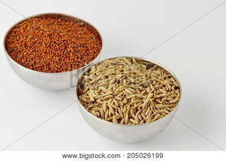 Cumin and Mustard seeds on white background