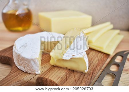 Camembert cheese, Edam cheese and olive oil as healthy fats, selective focus.