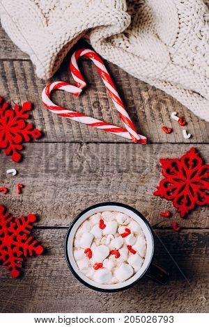 Hot Chocolate with Marshmallow and Holiday Decoration Knitted Blanket. Traditional Winter Christmas Drink. Copy Space Top view Frame