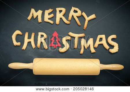 Seasonal background on a blackboard with the words Merry Christmas