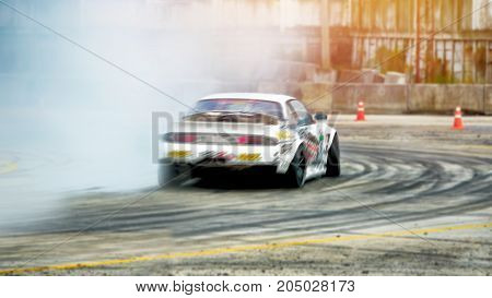 Abstract blurred car drift on speed track with smoke