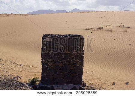 Pure road stone for inscription. Textured stela in desert for logo