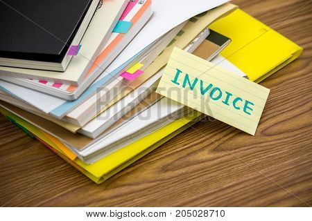 Invoice; The Pile Of Business Documents On The Desk