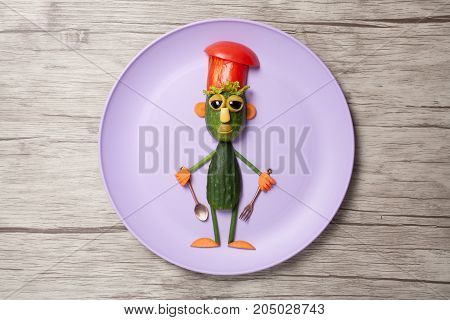 Chief made of cucumbers on purple plate