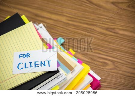 For Client; The Pile Of Business Documents On The Desk