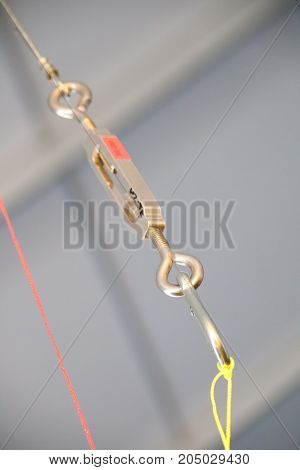 Cables And Hook Hanging From The Ceiling At The Construction Site