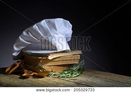 Old Culinary Books , Chef Hat And Wooden Spoons .